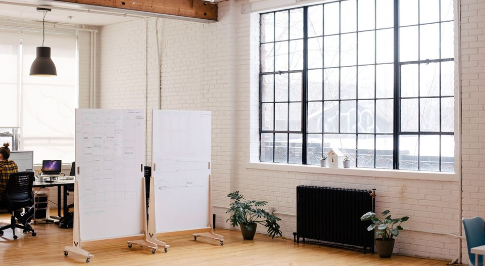 Wireframes written on whiteboard in loft office