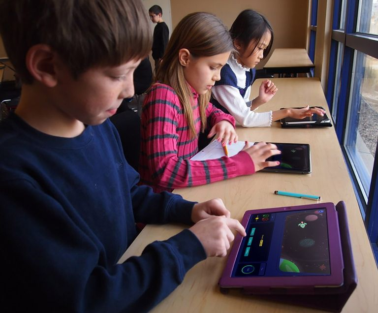 Children playing Educational game on iPads