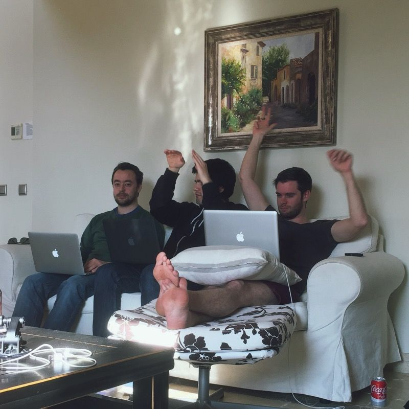 3 developers on a sofa