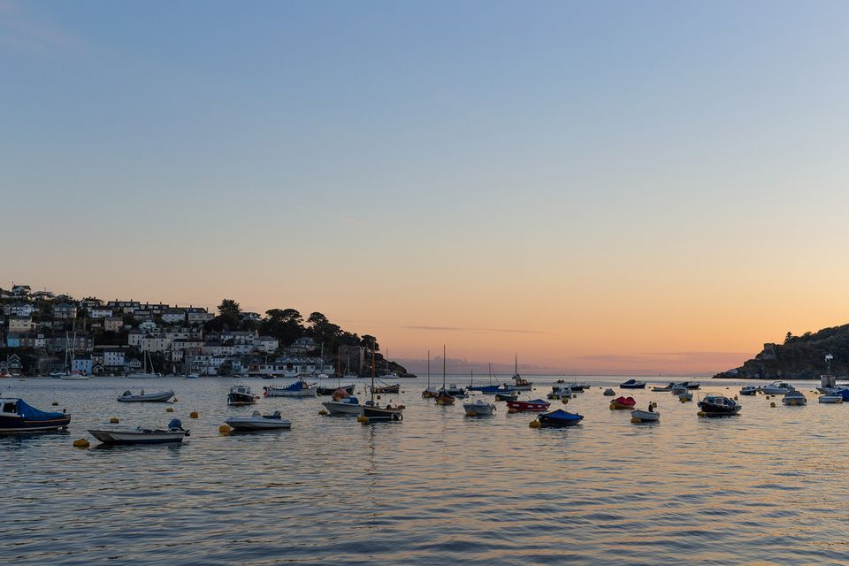 Boats in Fowey at sunset