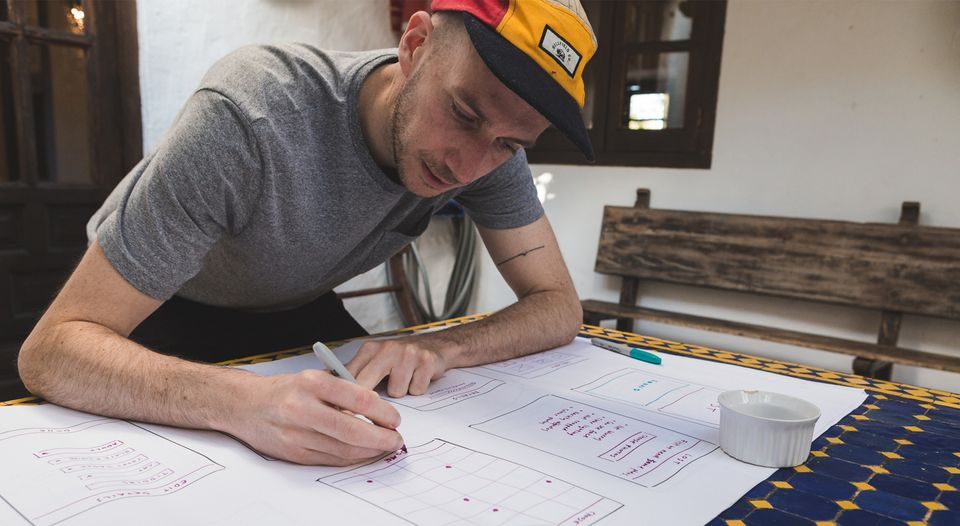 Matt lead designer drawing wireframes