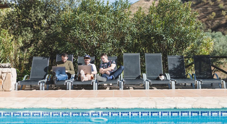 Gravitywell devs working poolside