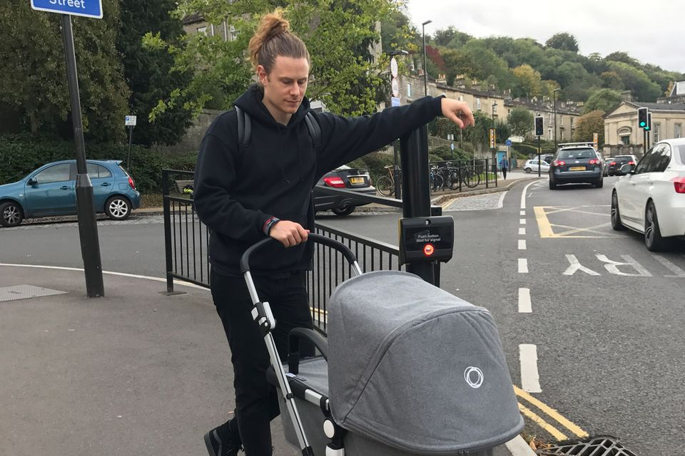 Hugo pushing a pram