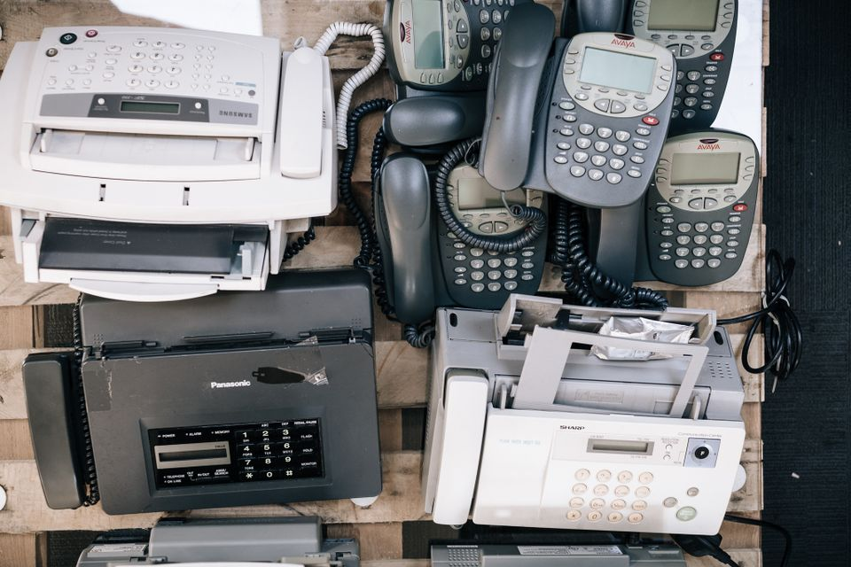 Pile of fax machines